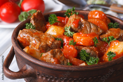 Fotografie, Obraz  stew in tomato sauce with vegetables close up in a pot