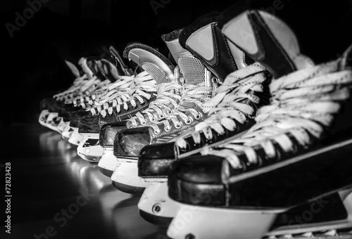 Photo  Hockey skates lined up in locker room