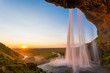 Seljalandsfoss, waterfall in Iceland, sunset and sunstar