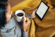 Young Woman Drinking Tea Readi...