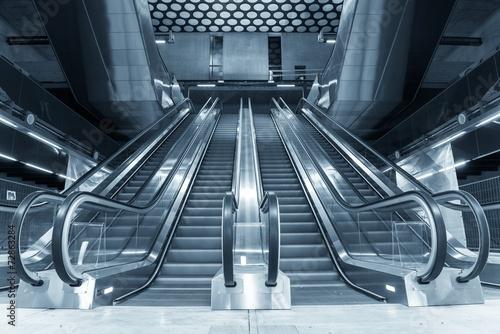 Fototapeta Moving escalator in the business center