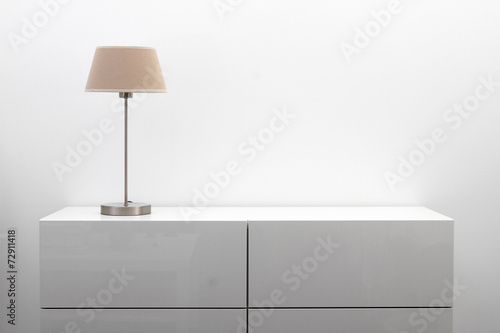 white commode with table lamp in bright minimalism interior Wallpaper Mural