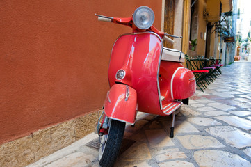 NaklejkaClassic Vespa scooter on Kerkyra street. Corfu island. Greece.