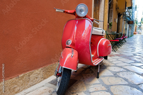 Classic Vespa scooter on Kerkyra street. Corfu island. Greece. Wallpaper Mural