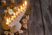 Jewish Holiday Hannukah Symbols - Menorah And Wooden Dreidels. C