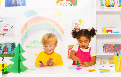 Boy And Girl Craft Together Forms Of Playing Dough Buy This Stock