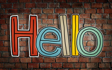 Word Hello On Brick Wall Backg...