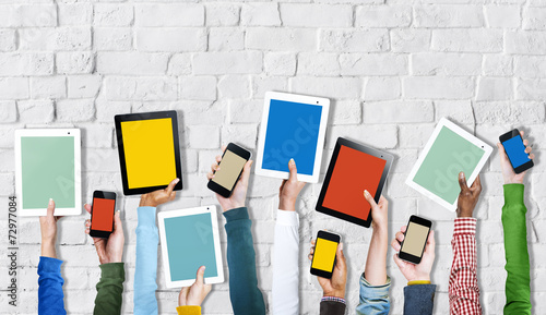 Fotografia  Group of Hands Holding Digital Devices