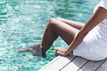 Woman Resting At Poolside With...
