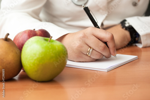 Nutrionist doctor writing
