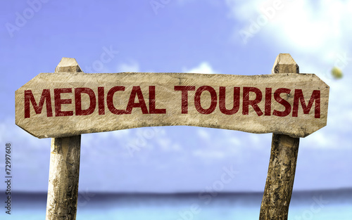 Fotografia  Medical Tourism sign with a beach on background