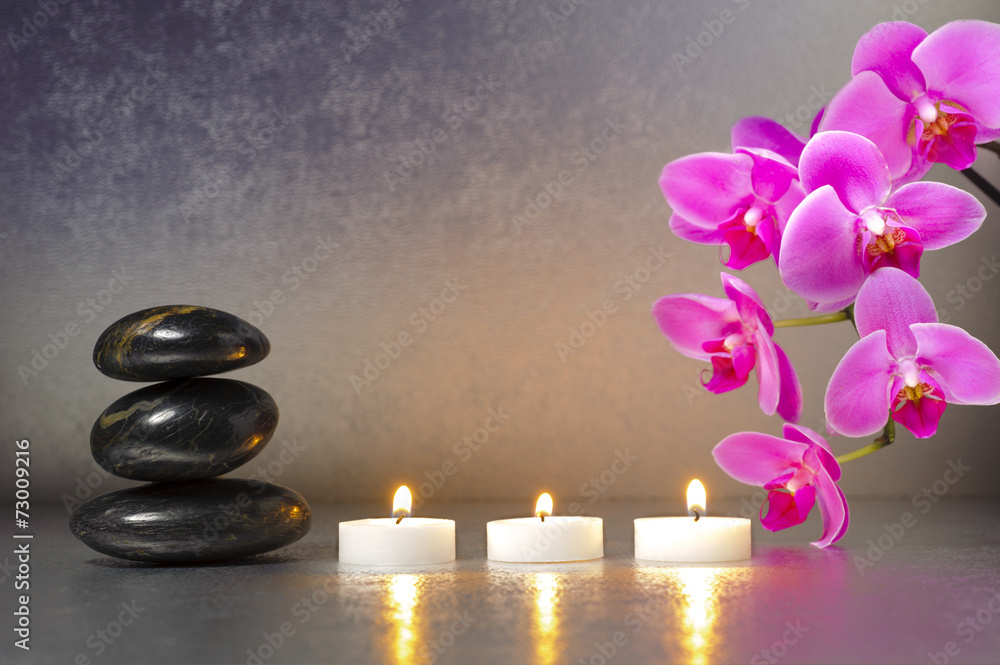 Fotografering  Japanese ZEN garden with stones, candle lights and orchid flower