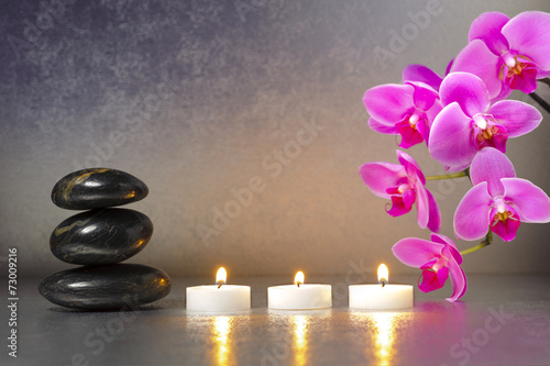 Japanese ZEN garden with stones, candle lights and orchid flower Poster