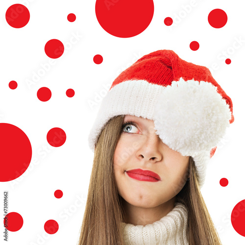 Valokuva  Cute teenage girl with Christmas hat looking up