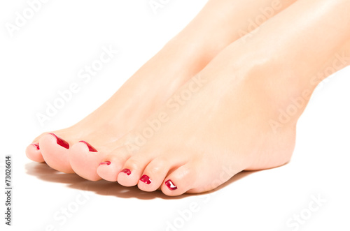 Wall Murals Pedicure Beautiful female foot with red pedicure
