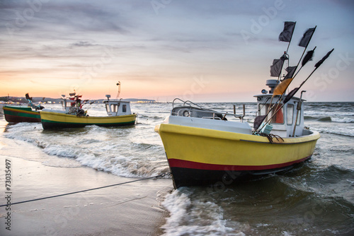Fishing boats on Baltic Sea beach in Karlikowo, Sopot, Poland