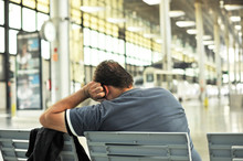 Man Sleeping On A Bench In The Station