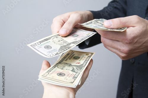 Fotografía  Money in the hands of the people