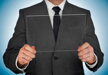 Businessman Holding A Transpae...