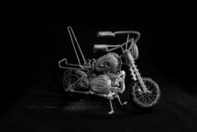 A Miniature Figurine Of A Motorcycle With A Wire