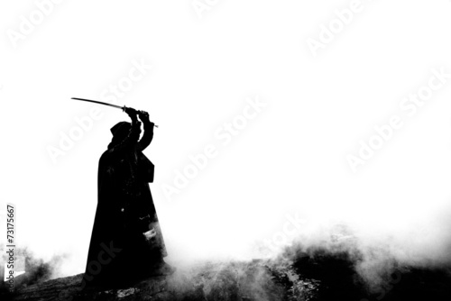 Photo  Woman killer holding Japanese sword on a post-apocalyptical