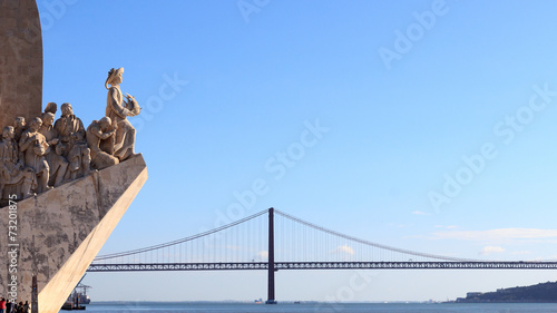 Photo  Monument to the Discoveries and 25 de Abril Bridge in Lisbon