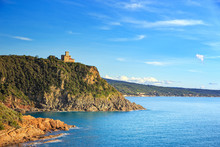 Cliff Rock And Building On The Sea On Sunset. Quercianella, Tusc