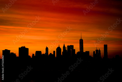 Silhouette of downtown Manhattan skyline at sunset