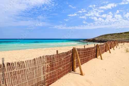 In de dag Australië Fence on beautiful sandy beach Cala Mesquida, Majorca island