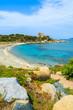 Beautiful bay with beach and castle, Sardinia island, Italy