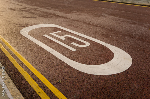Fotografía  Speed Limit Painted on a Road