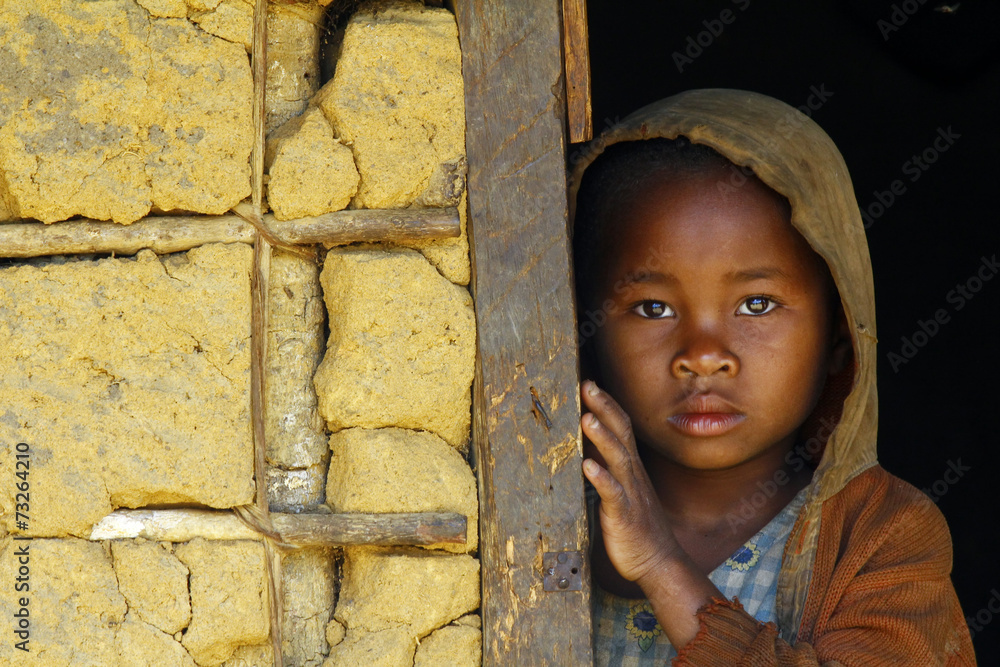 Fototapeta Madagascar-shy and poor african girl with headkerchief