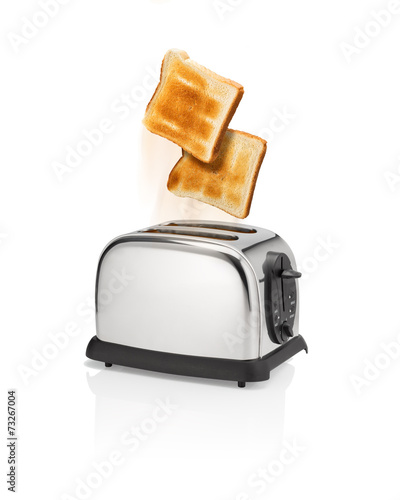Roasted bread pops out from toaster.
