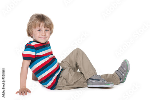 Fotografie, Obraz  Blond boy sits on the floor