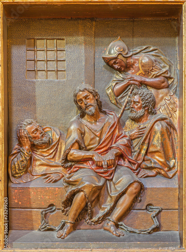 Photo Seville - carved relief of St. John the Baptist in prison