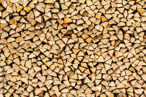 stack birch firewood in Russia #73317447