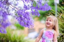 Happy Little Girl Has A Fun In...