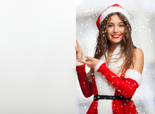 Woman Dressed For Christmas Showing A Blank Board