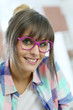 Portrait of young trendy girl with eyeglasses