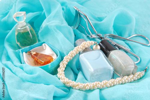Fototapeta beauty accessories on blue scarf obraz na płótnie
