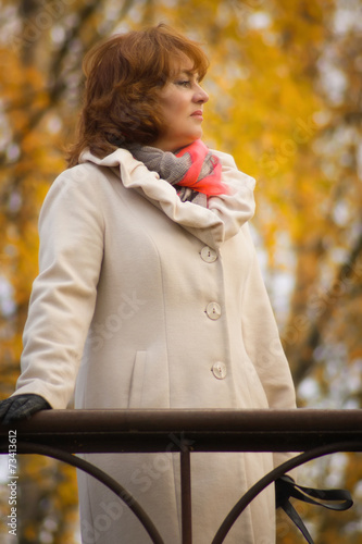 Fotografie, Obraz  Elegant middle-aged woman in the autumn park