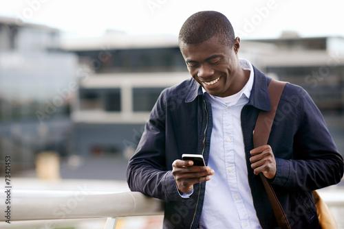 Fényképezés  smiling phone african man