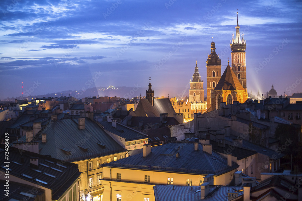 Fototapety, obrazy: Top view of the rooftops of the old town of Krakow at night.