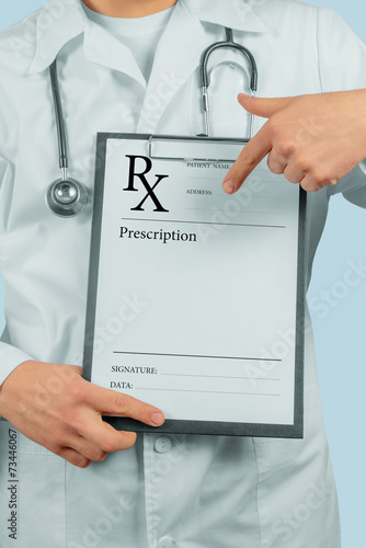 Fotografia  Doctor pointing on clipboard with prescription paper
