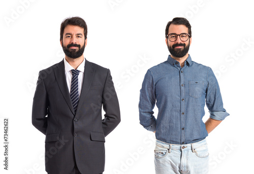 Photo Twin brothers over isolated white background