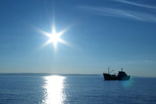 Silhouette Of A Fishing Boat