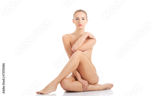 Front view nude woman sitting on the floor