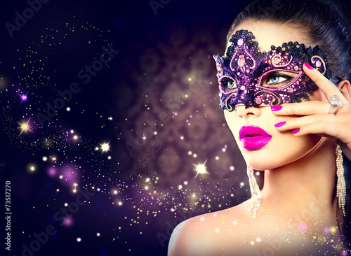 Deurstickers Carnaval Sexy woman wearing carnival mask over holiday dark background