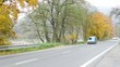 road with cars in countryside (autumn nature) - trees and river