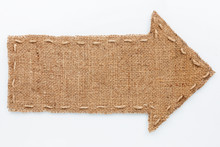 Arrow Of Burlap  Lies On A White  Background